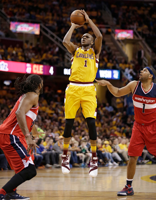 . Cleveland Cavaliers\' James Jones (1) shoots against the Washington Wizards in the second half of an NBA basketball game Friday, March 4, 2016, in Cleveland. (AP Photo/Tony Dejak)
