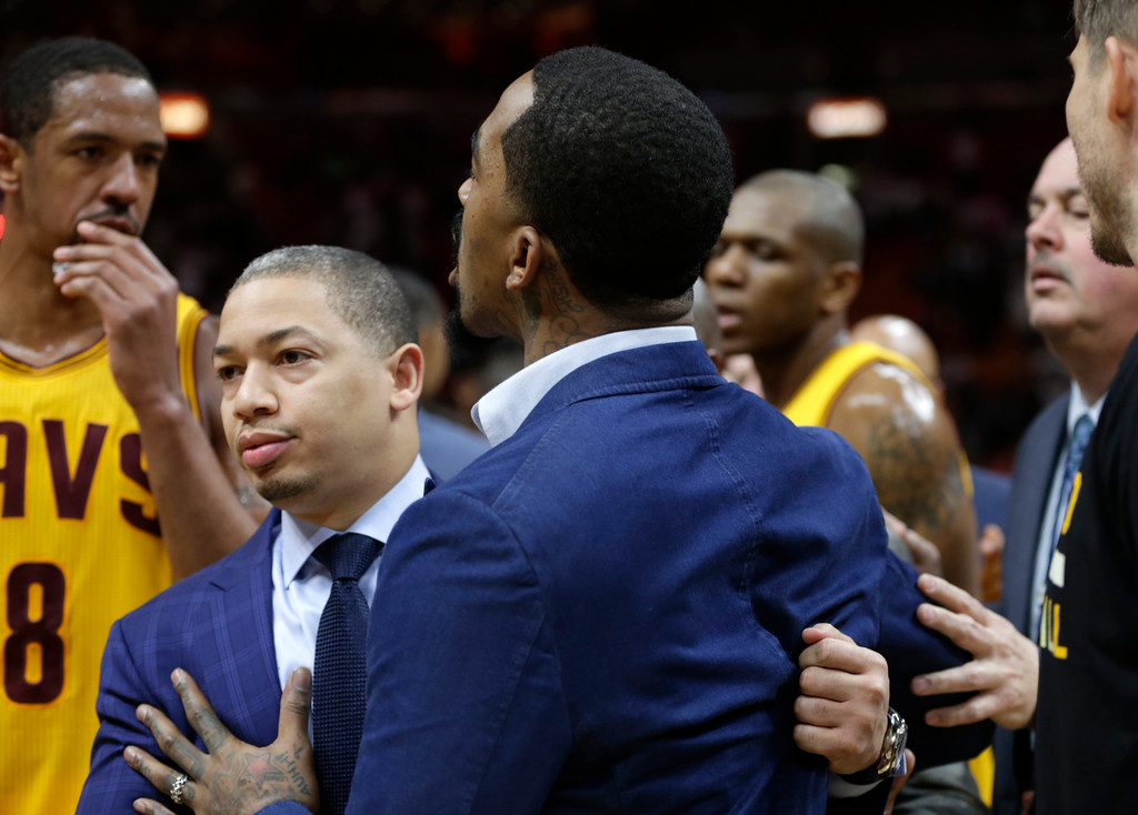 . Cleveland Cavaliers head coach Tyronn Lue, left, restrains J.R. Smith, right, after an NBA basketball game against the Miami Heat, Saturday, March 4, 2017, in Miami. The Heat defeated the Cavaliers 120-92. (AP Photo/Lynne Sladky)