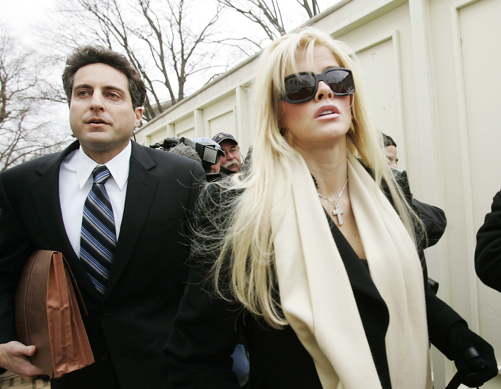 . Anna Nicole Smith, right, arrives at the U.S. Supreme Court with her attorney Howard K. Stern, Tuesday, Feb. 28, 2006, in Washington. (AP Photo/Manuel Balce Ceneta)