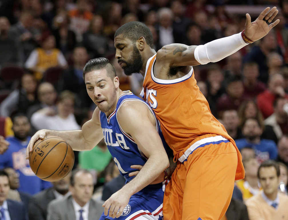 . Philadelphia 76ers\' T.J. McConnell, left, drives past Cleveland Cavaliers\' Kyrie Irving in the second half of an NBA basketball game, Friday, March 31, 2017, in Cleveland. (AP Photo/Tony Dejak)