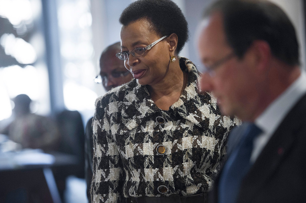 ". French President Francois Hollande (R) and Nelson Mandela\'s wife Graca Machel (L) visit the Mandela foundation on October 15, 2013 in Soweto. Hollande arrived in South Africa for a two-day state visit, during which he is set to push for greater cooperation on African crises with the continental powerhouse. Hollande paid a ""very emotional\"" visit to the small house in Soweto where peace icon Nelson Mandela lived before his 27-year-imprisonment. (FRED DUFOUR/AFP/Getty Images)"