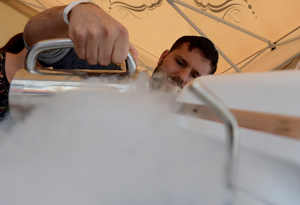 . Ryan Berk, chef and owner of A La Minute, prepare ice cream for a Redlands Bicycle Classic spectator Sunday April 7, 2013. Crowds of spectators gather along the streets of Redlands for the final day of the 29th Annual Redlands Bicycle Classic. Rick Sforza/Staff photographer