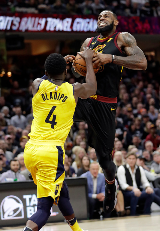 . Cleveland Cavaliers\' LeBron James (23) drives to the basket against Indiana Pacers\' Victor Oladipo (4) in the first half of a first-round playoff series in an NBA basketball game, Sunday, April 15, 2018, in Cleveland. (AP Photo/Tony Dejak)