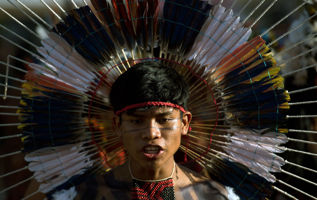 . A native sings during the sacred fire ceremony, on the eve of the official opening ceremony of the first International Games of Indigenous Peoples in Cuiaba, state of Mato Grosso, on November 8, 2013. 48 Brazilian ethnic groups and indigenous representatives from 16 countries are taking part in the event which runs until November 16. AFP PHOTO / CHRISTOPHE SIMON