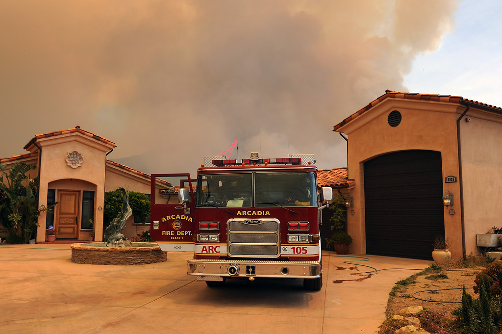 . An Arcadia Fire Department truck is stationed at a home on Deer Creek Road in Ventura County, Friday, May 3, 2013. (Michael Owen Baker/Los Angeles Daily News)