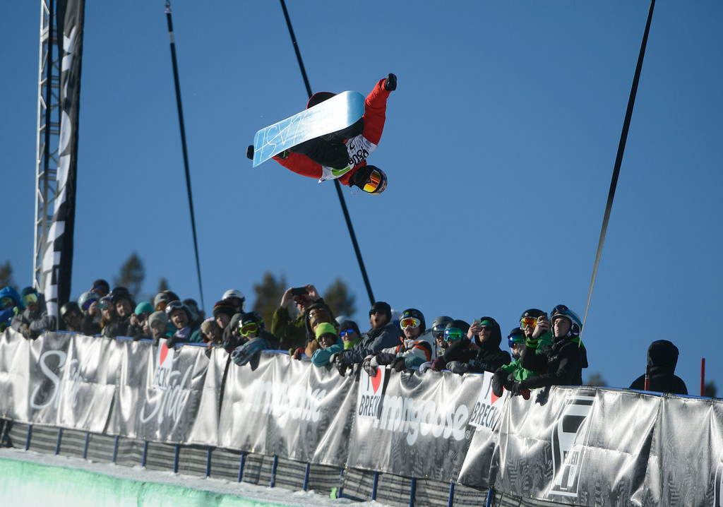 . Pro Snowboarder, Greg Bretz, launches on his first run of the Dew Tour Ion Mountain superpipe championship finals at Breckenridge Saturday afternoon, December 14, 2013. Bretz\'s run was good enough to edge out Shaun White for first place with a score of 91.40. (Photo By Andy Cross/The Denver Post)