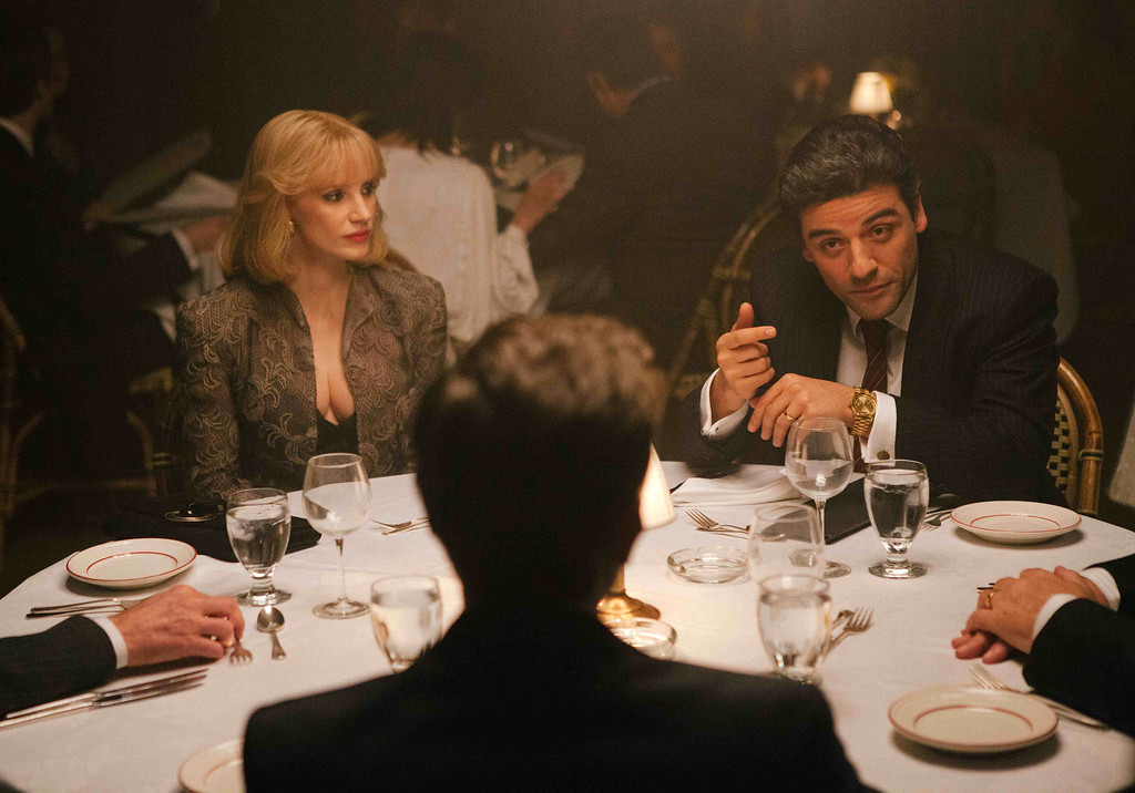 """. In this image released by A24 Films, Jessica Chastain, left, and Oscar Isaac appear in a scene from \""""A Most Violent Year.\"""" Chastain was nominated for a Golden Globe for best supporting actress in a drama for her role in the film on Thursday, Dec. 11, 2014. The 72nd annual Golden Globe awards will air on NBC on Sunday, Jan. 11. (AP Photo/A24 Films, Atsushi Nishijima)"""