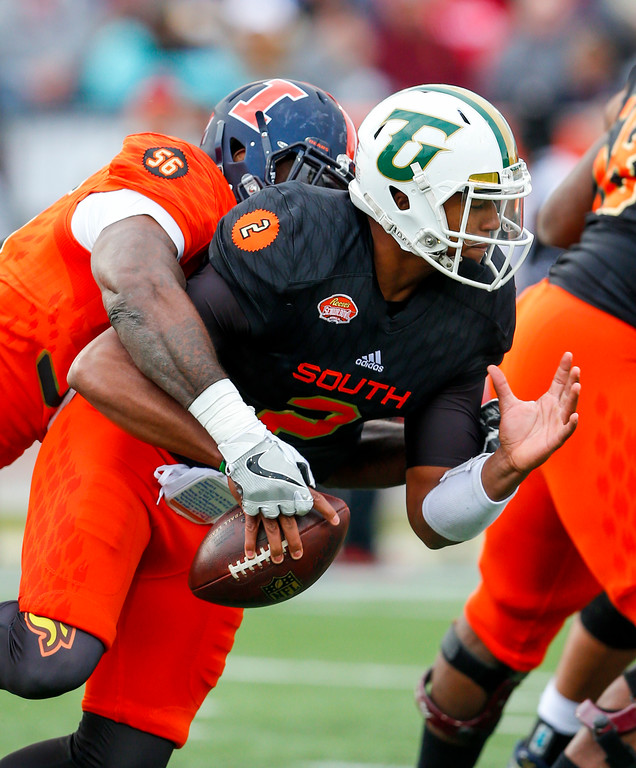 . South squad quarterback Antonio Pipkin of Tiffin (2) is sacked by North squad outside linebacker Carroll Phillips of Illinois (56) during the second half of the Senior Bowl NCAA college football game, Saturday, Jan. 28, 2017, at Ladd-Peebles Stadium in Mobile, Ala. (AP Photo/Butch Dill)