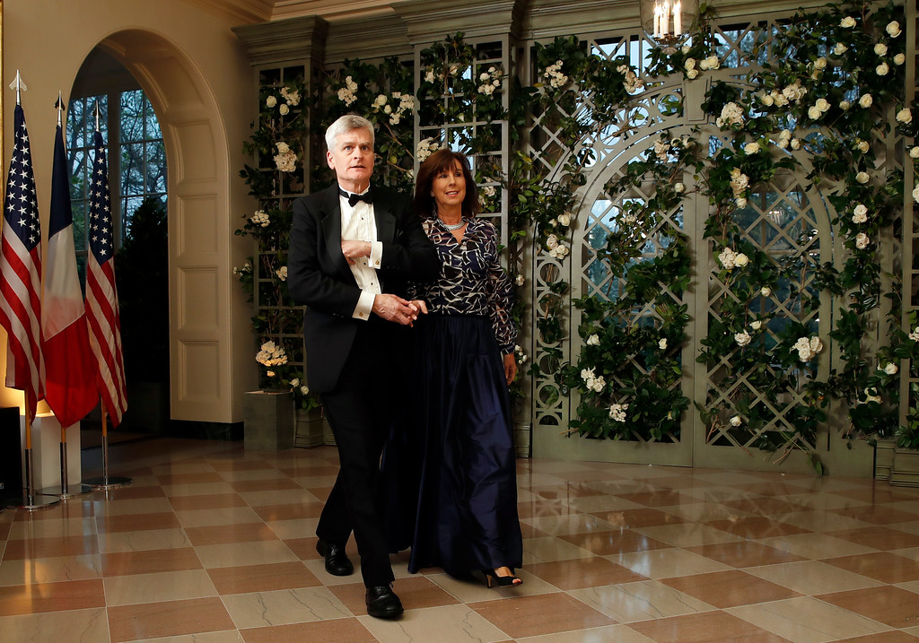 . Sen. Bill Cassidy, R-La., and his wife Dr. Laura Cassidy arrive for a State Dinner with French President Emmanuel Macron and President Donald Trump at the White House, Tuesday, April 24, 2018, in Washington. (AP Photo/Alex Brandon)
