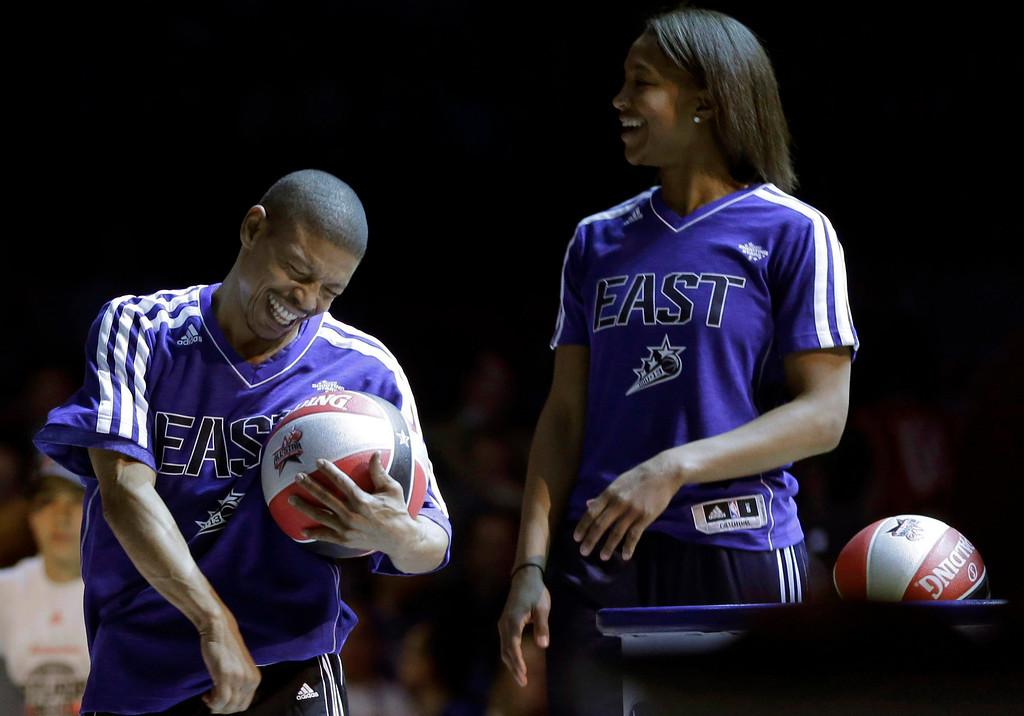 . Former NBA player Muggsy Bogues and  Indiana Fever\'s Tamika Catchings react at the skills challenge during NBA All-Star Saturday Night basketball in Houston on Saturday, Feb. 16, 2013. (AP Photo/Eric Gay)
