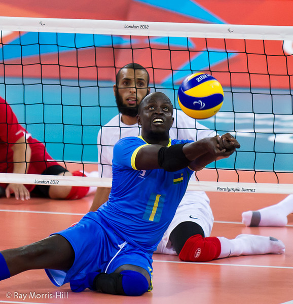Sitting Volleyball at Excel, 7 September 2012. Dominique Bizimana of Rwanda digs deep.  Rwanda won 3-1 against Morocco in the 9-10 Classification match. It was the first ever victory by a sub-Saharan African team.