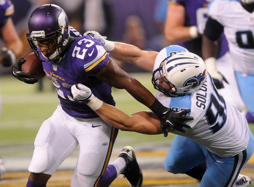 . Vikings running back Joe Banyard, left, escapes Titans linebacker Scott Solomon for a seven yard gain during the fourth quarter. Banyard gained 62 yards on the ground and 54 yards in the air (including an 11-yard touchdown reception) during the game.  (Pioneer Press: Sherri LaRose-Chiglo)