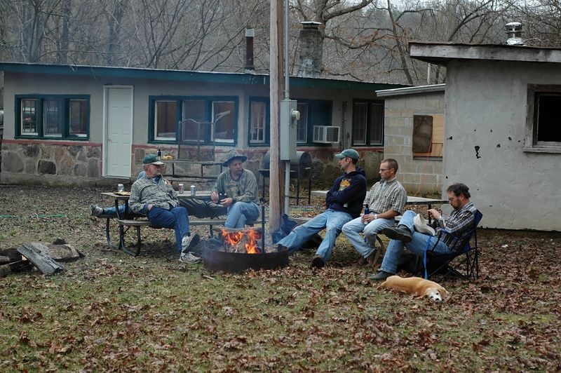 The boys sit around the campfire and recount the day's events.