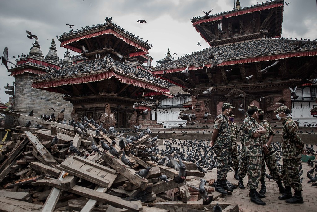 . Nepalese soldiers stand next to wrecked buildings at Durbar square, a UNESCO world heritage site that was badly damaged by the earthquake, in the historical centre of Kathmandu on April 29, 2015,  following a 7.8 magnitude earthquake which struck the Himalayan nation on April 25. Rescuers are facing a race against time  to find survivors of a mammoth earthquake that killed more than 5,000 people when it through Nepal five days ago and devastated large parts of one of Asia\'s poorest nations.    AFP PHOTO / Philippe  LOPEZ/AFP/Getty Images