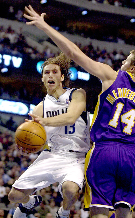 . Dallas Mavericks\' Steve Nash (13) drives to the basket against Los Angeles Lakers\' Stanislav Medvedenko (14) during the fourth quarter in Dallas, Tuesday, Nov. 19, 2002.  The Mavericks won, 98-72. (AP Photo/LM Otero)
