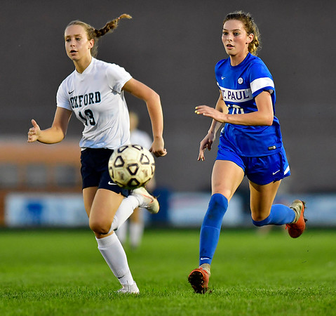 10/10/2018 Mike Orazzi | Staff St. Paul Girls Soccer's Reagan Davis (10) Oxford's Sage Borkowski (13) at SPCHS Wednesday night.