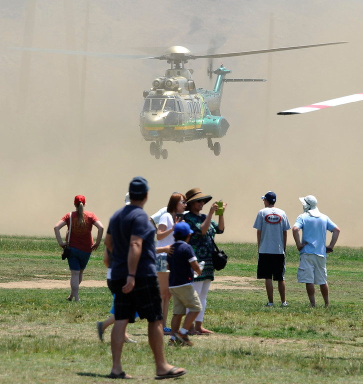 . LA county sheriff air-5 kicks up the dust during the 20th anniversary of American Heroes Air Show Courage at the Speed of Flight at Hansen Dam. Lake View Terrace CA.  June 29,2013. Photo by Gene Blevins/LA Daily News