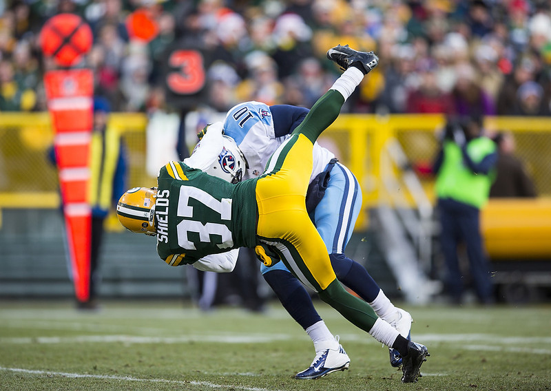 . Sam Shields #37 of the Green Bay Packers sacks Jake Locker #10 of the Tennessee Titans at Lambeau Field on December 23, 2012 in Green Bay, Wisconsin.  (Photo by Tom Lynn /Getty Images)