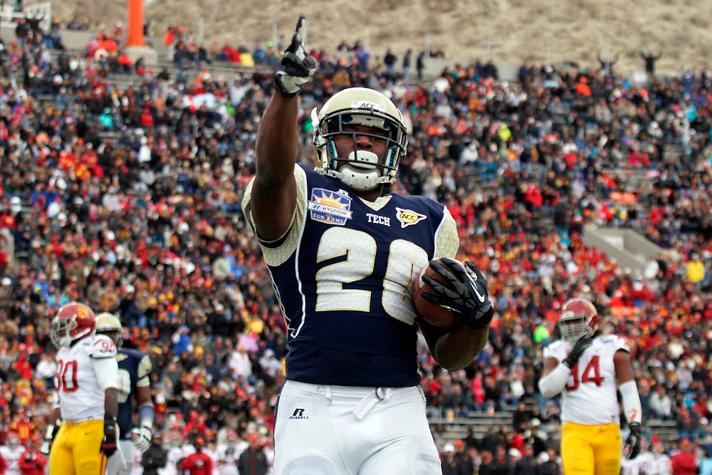 Description of . Georgia Tech running back David Sims celebrates his touchdown against Southern California during the first half of the Sun Bowl NCAA college football game, Monday, Dec. 31, 2012, in El Paso, Texas. (AP Photo/Mark Lambie)