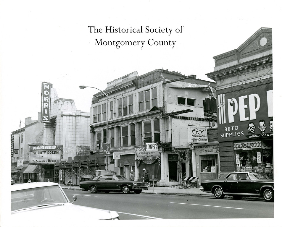 ". This photo from the Historical Society of Montgomery County shows the Wildman Building in Norristown as it was being taken down in 1968. To the left, the sign at the Norris Theater shows ""The Dirty Dozen\"" was playing at the time."