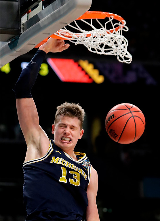 . Michigan\'s Moritz Wagner (13) dunks during the second half in the championship game of the Final Four NCAA college basketball tournament against Villanova, Monday, April 2, 2018, in San Antonio. (AP Photo/Eric Gay)