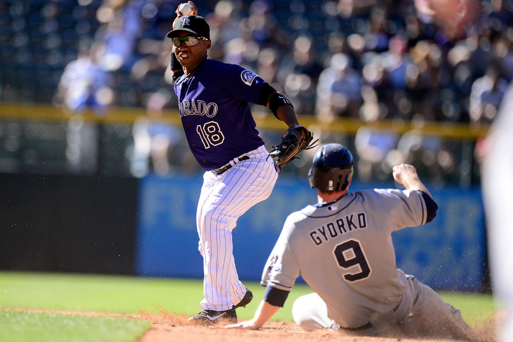 . DENVER, CO - JUNE 9: Colorado Rockies shortstop Jonathan Herrera (18) gets San Diego Padres second baseman Jedd Gyorko (9) out at second but cannot convert the double play on right fielder Kyle Blanks (88) during the Rockies\' 7-8 10-inning win in Denver. The Colorado Rockies hosted the San Diego Padres. (Photo by AAron Ontiveroz/The Denver Post)