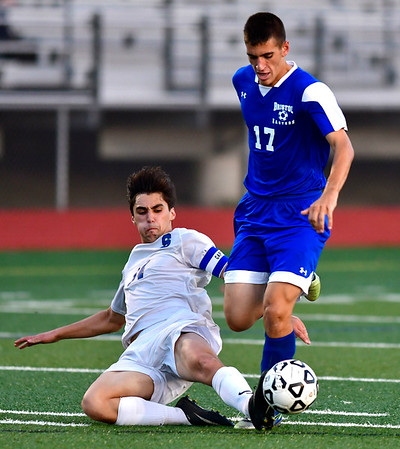 10/9/2018 Mike Orazzi | Staff Bristol Eastern's Ben Chiasson (17) and Southington's Joseph Colaccino (14) at BEHS Tuesday.