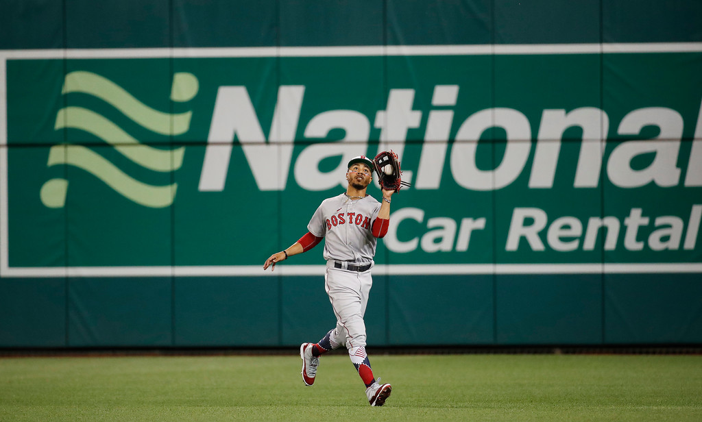 . Boston Red Sox outfielder Mookie Betts (50) catches a fly ball hit by Chicago Cubs second baseman Javier Baez (9) in the fifth inning dat the Major League Baseball All-star Game, Tuesday, July 17, 2018 in Washington. (AP Photo/Alex Brandon)