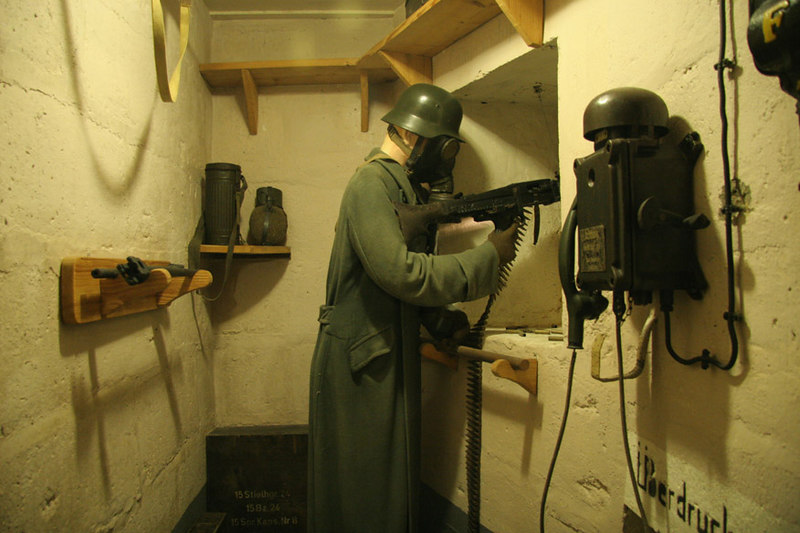 Display inside La Grand Bunker.  This is the Nazi soldier protecting the main entrance into the bunker.  He shoots down a narrow concrete pasageway which is the only way into the bunker.