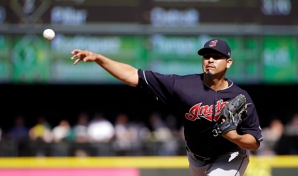 . Cleveland Indians starting pitcher Carlos Carrasco throws against the Seattle Mariners in the second inning of a baseball game Saturday, Sept. 23, 2017, in Seattle. (AP Photo/Elaine Thompson)