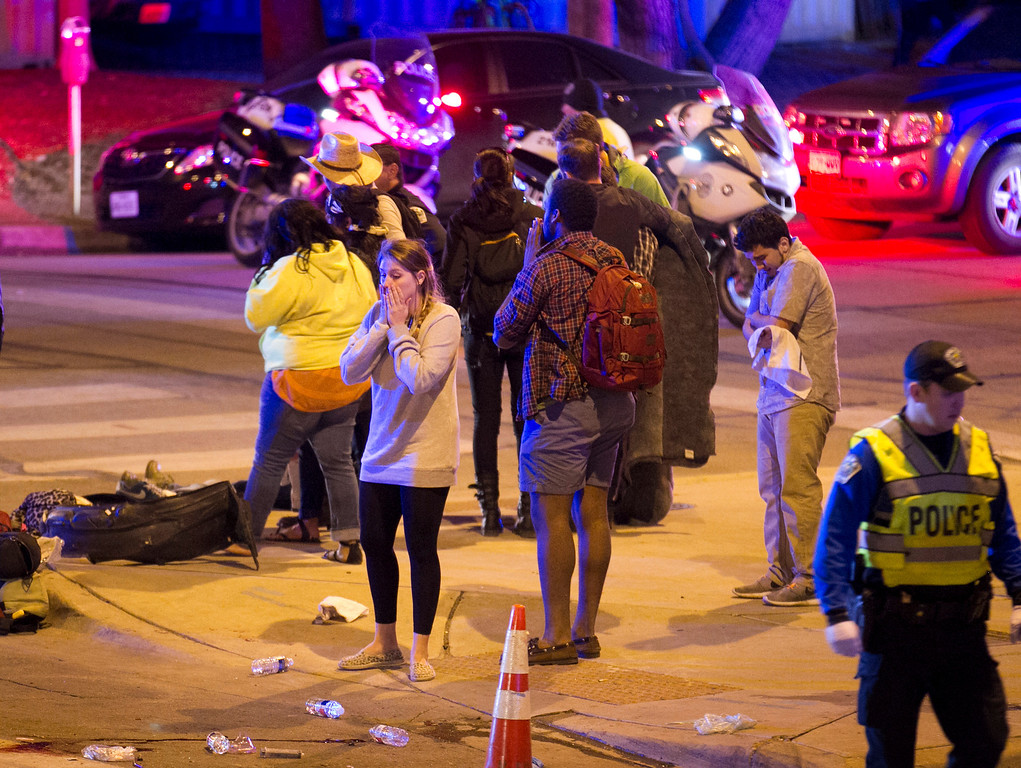 . Bystanders react after several people were struck by a vehicle on Red River Street in downtown Austin, Texas, at SXSW on Wednesday March 12, 2014.   (AP Photo/Austin American-Statesman, Jay Janner)