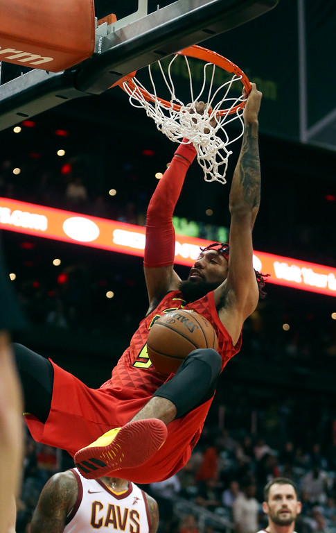 . Atlanta Hawks forward DeAndre\' Bembry (95) scores against the Cleveland Cavaliers in the first half of an NBA basketball game Thursday, Nov. 30, 2017, in Atlanta. (AP Photo/John Bazemore)
