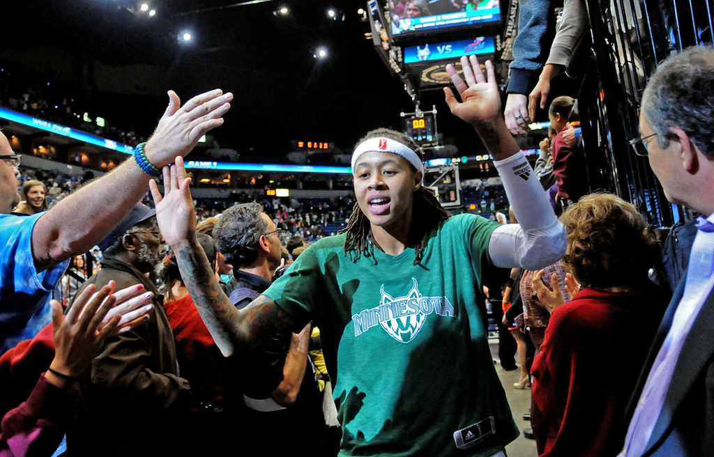 . Minnesota\'s Seimone Augustus is greeted by fans as she leaves the court after the Lynx\'s 84-59 victory over the Atlanta Dream in Game 1 of the WNBA Finals.  (Pioneer Press: Sherri LaRose-Chiglo)