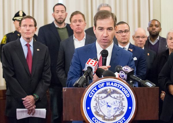 01/10/20 Wesley Bunnell | Staff Hartford Mayor Luke Bronin addresses the media during a conference on Friday afternoon. Senator Richard Blumenthal along with Governor Ned Lamont, Hartford Mayor Luke Bronin, Lt. Gov. Susan Bysiewicz, other government officials and community activists mets at Hartford City Hall on Friday afternoon to discuss how to help Puerto Rico after a series of earthquakes recently. The Senator called for fair and affordable prices on airline tickets leaving Puerto Rico which have skyrocketed in price. Others noted the Trump administrations failure to release federal funding already designated for relief efforts two years ago after Hurricane Maria.