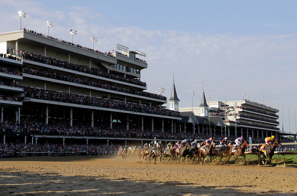 . Horses run during the 142nd running of the Kentucky Derby horse race at Churchill Downs Saturday, May 7, 2016, in Louisville, Ky. (AP Photo/Darron Cummings)