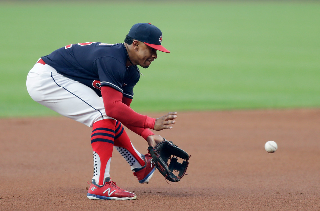 . Cleveland Indians\' Francisco Lindor fields a ball hit by Minnesota Twins\' Logan Forsythe in the first inning of a baseball game, Tuesday, Aug. 28, 2018, in Cleveland. Forsythe was safe at first base on a fielders choice. (AP Photo/Tony Dejak)