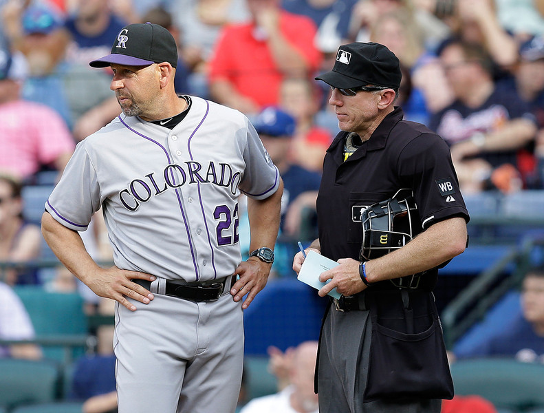 . Colorado Rockies manager Walt Weiss #22 talks with home plate umpire Lance Barksdale to request a review on a play at home plate in the seventh inning of the game against the Atlanta Braves at Turner Field on May 24, 2014 in Atlanta, Georgia.  (Photo by Mike Zarrilli/Getty Images)