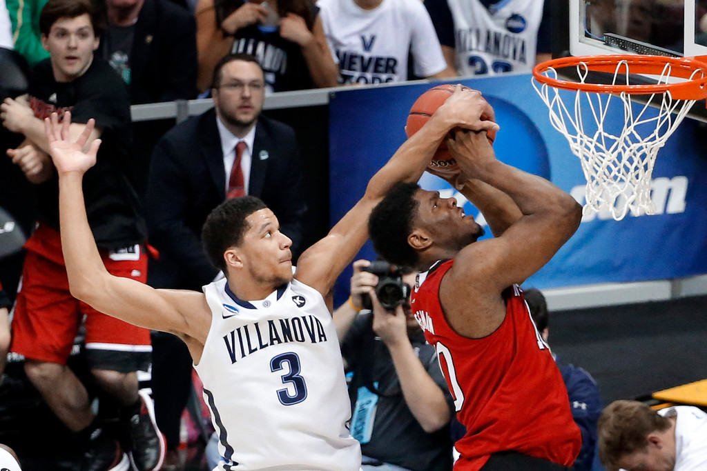. Villanova\'s Josh Hart (3) blocks a shot by North Carolina State\'s Lennard Freeman during the second half of an NCAA tournament third-round college basketball game, Saturday, March 21, 2015, in Pittsburgh. (AP Photo/Gene J. Puskar)