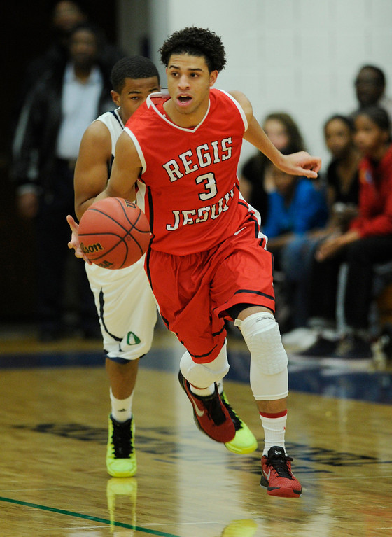 . Raiders guard Josh Perkins started the ball downcourt in the first half. The Overland High School boy\'s basketball team hosted Regis Jesuit Tuesday night, December 11, 2012.  Karl Gehring/The Denver Post