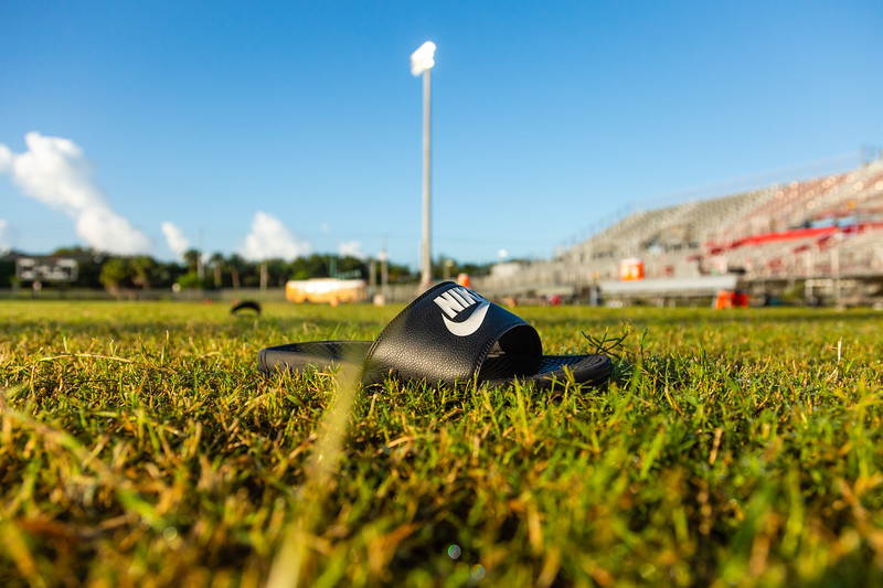 A flip flop remains on the field at Palm Beach Central High School after a shooting on  Friday night, August 17, 2018. Photo captured on  Saturday, August 18, 2018. (Joseph Forzano / The Palm Beach Post)