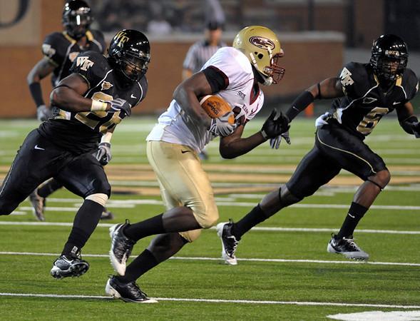J Jones and K Okoro chase T Hudgins.jpg
