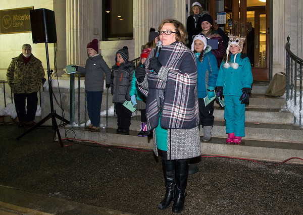12/03/19 Wesley Bunnell | Staff The 68th annual Bristol Carol Sing and 29th annual Tree Lighting presented by Webster Bank and the Central CT Chambers of Commerce took place on Tuesday night outside to Webster Bank at 150 Main St. Mayor Ellen Zoppo-Sassu addresses the audience.