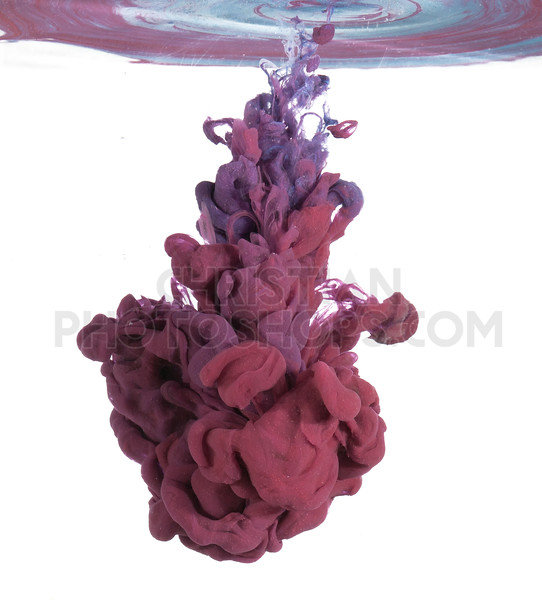 Purple paint in water on white background