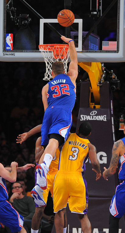 . Blake Griffin goes over the shoulder of Shawne Williams on an unsuccessful shot in the NBA season opener between the Lakers and Clippers at Staples Center in Los Angeles, CA on Tuesday, October 29, 2013.  Lakers won 116-103. (Photo by Scott Varley, Daily Breeze)