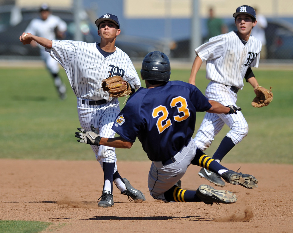 . Montebello second baseman Richard Santoscoy (#5) forces out Alhambra\'s Alan Rivera (#23) as he throws to complete the double play in their Almont League baseball game at Montebello High School in Montebello  on Friday April 19, 2013. (SGVN/Staff Photo by Keith Durflinger)