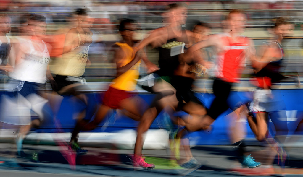. Athletes competes in the 1600 meter run during the CIF-SS Masters Track and Field meet at Falcon Field on the campus of Cerritos College in Norwalk, Calif., on Friday, May 30, 2014.   (Keith Birmingham/Pasadena Star-News)