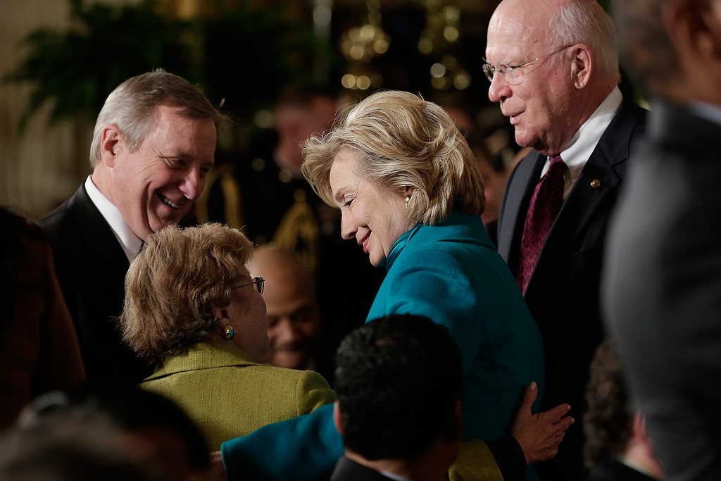 . Former U.S. Secretary of State Hillary Clinton greets guests before U.S. President Barack Obama awarded former U.S. President Bill Clinton the Presidential Medal of Freedom in the East Room at the White House on November 20, 2013 in Washington, DC.  (Photo by Win McNamee/Getty Images)