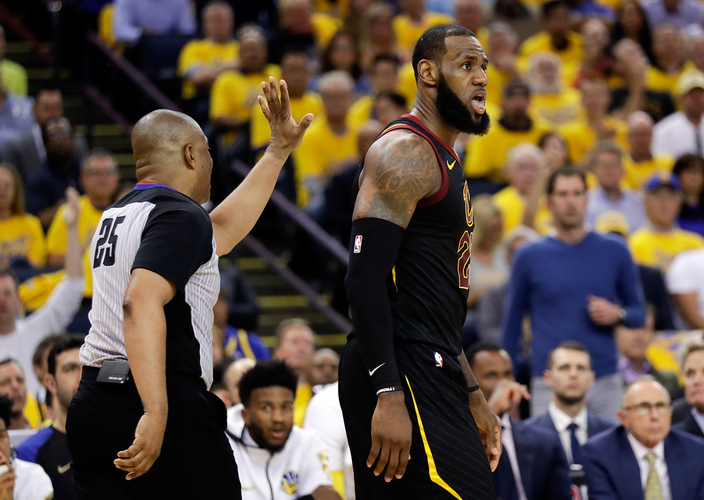 . Cleveland Cavaliers forward LeBron James reacts during the second half of Game 1 of basketball\'s NBA Finals between the Golden State Warriors and the Cavaliers in Oakland, Calif., Thursday, May 31, 2018. (AP Photo/Marcio Jose Sanchez)
