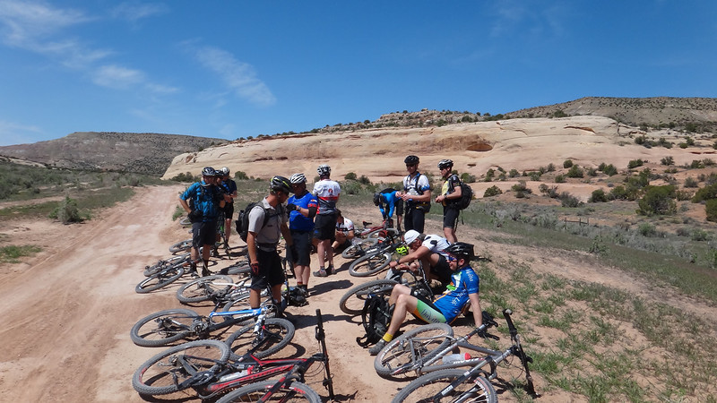 . Riders take a mid-morning break at Castle Rocks -- where Trail 2 meets up with Kokopelli\'s Trail --  in western Colorado. Handout Photo