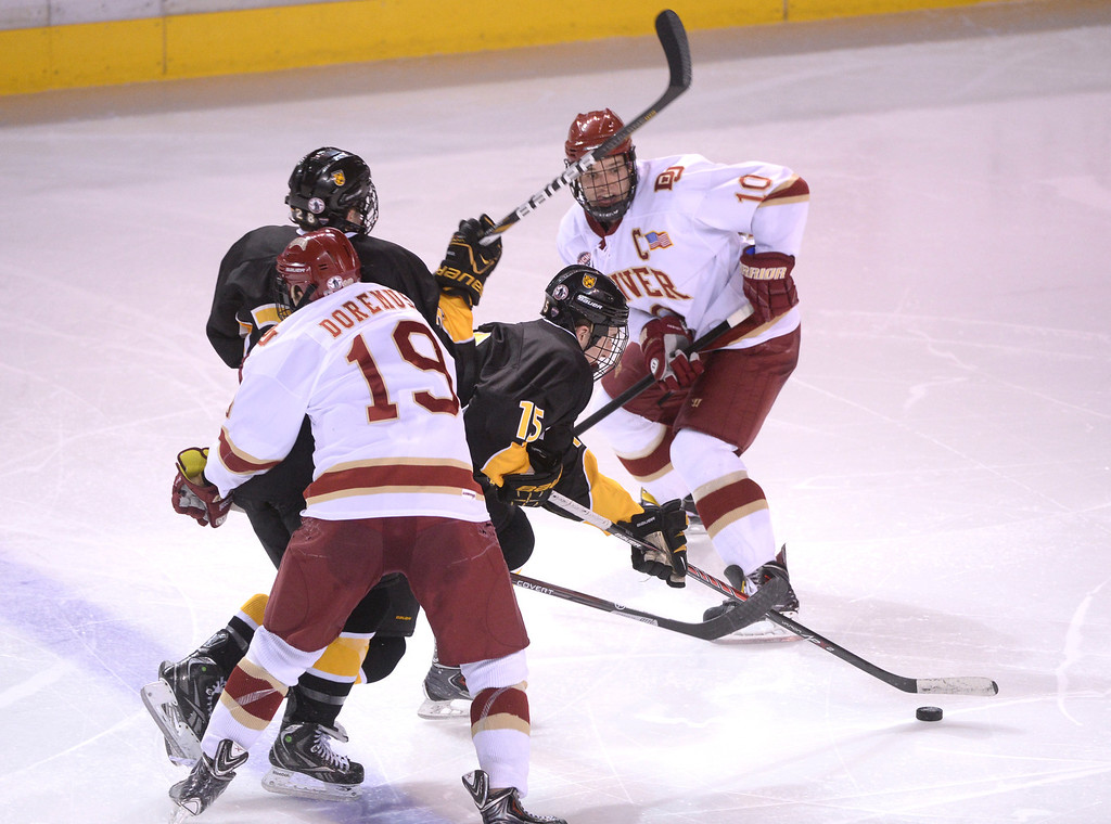 . DENVER, CO. - FEBRUARY 21, 2014: The Colorado College hockey team defeated Denver 3-2 at Magness Arena Friday night, February 21, 2014. Photo By Karl Gehring/The Denver Post